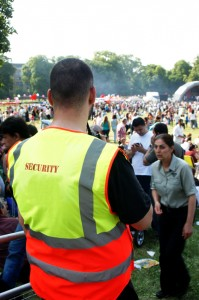 Security guard watches the crowd during one of the summer outdoor music festivals.