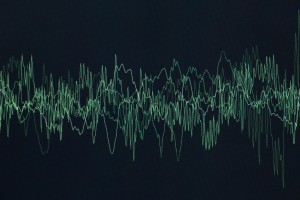 sound or audio waves oscillating on black background